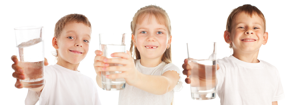Children with a water glass